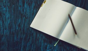 white bullet journal ideas for work on a blue surface
